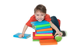 Laughing little boy with books Royalty Free Stock Images