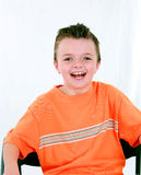 Laughing Little boy in chair Royalty Free Stock Photo