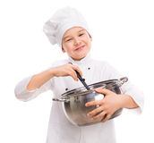 Laughing little boy-cook with pan in hands. Isolated on white background Royalty Free Stock Photos