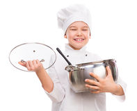 Laughing little boy-cook with pan in hands. Laughing little boy-cook with pan and lid in hands isolated on white background Royalty Free Stock Photo