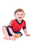 Laughing little boy with cookies in hand. On white background Royalty Free Stock Photo