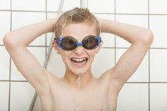 Laughing little boy having fun in the shower royalty free stock photography