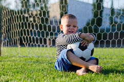 Laughing little boy with his soccer Royalty Free Stock Images
