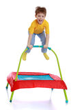 Laughing little boy jumping on a trampoline Royalty Free Stock Images