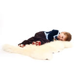 Laughing little boy laying on floor Royalty Free Stock Photography