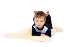 Laughing little boy laying on floor Royalty Free Stock Photos
