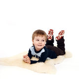 Laughing little boy laying on floor Stock Photos