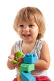 Laughing little boy playing with blocks. Isolated on white background Royalty Free Stock Image