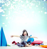 Laughing little boy playing plane toy Stock Image