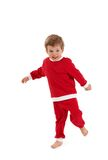 Laughing little boy in santa costume Royalty Free Stock Photo