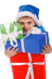Laughing little boy in Santa's hat Stock Photography