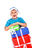 Laughing little boy in Santa's hat Stock Photos