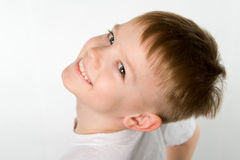 Laughing little boy in t-shirt under the original foreshortening   angel Stock Image