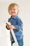 Laughing little boy at the top of a ladder Stock Photography