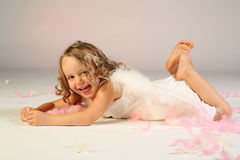 Laughing little girl angel Stock Image
