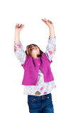 Laughing little girl with arms up Stock Photos