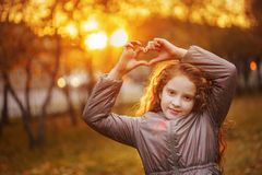 Laughing little girl in autumn park. stock images