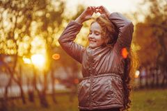 Laughing little girl in autumn park. royalty free stock photo