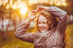 Laughing little girl in autumn park. stock photos
