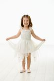 Laughing little girl in ballet costume Royalty Free Stock Image