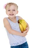 Laughing little girl with a bunch of bananas mouse. Isolated on white Royalty Free Stock Image