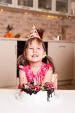 Laughing little girl celebrating happy birthday royalty free stock photo