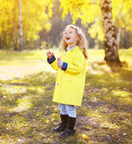 Laughing little girl child wearing yellow jacket Royalty Free Stock Images