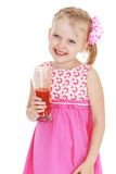 Laughing little girl with a glass of tomato juice. Happy childhood, the family concept.Laughing little girl with a glass of tomato juice in hand.Isolated on Royalty Free Stock Photography