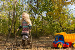 Laughing little girl having fun playing outdoors Stock Photos