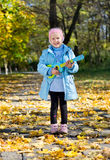 Laughing little girl with her toy guitar Royalty Free Stock Images
