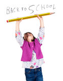 Laughing Little Girl Holding A Big Pencil Stock Photos
