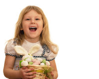 Laughing little girl holding Easter basket Stock Images