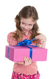 Laughing little girl holds a gift box Stock Photography
