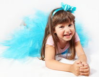 Laughing Little Girl Laying Stock Images