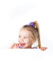 Laughing little girl looking over empty board Royalty Free Stock Images