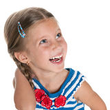 Laughing little girl looks aside Stock Images