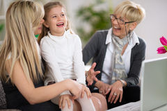 Laughing little girl with mother and grandmother Royalty Free Stock Photos