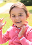 Laughing little girl. In pink pullover Royalty Free Stock Photos