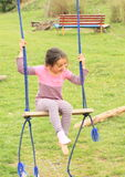 Laughing little girl on swing Stock Photos