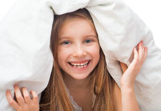 Laughing little girl under a blanket Royalty Free Stock Photos