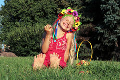 Laughing little girl in wreath Royalty Free Stock Image