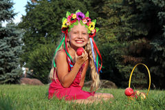 Laughing little girl in wreath Stock Photos