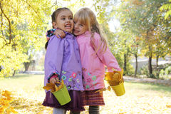 Laughing little girls having fun in autumn park Stock Images