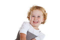 Laughing little kid. Cute little three year old laughing a bit shy Royalty Free Stock Photos