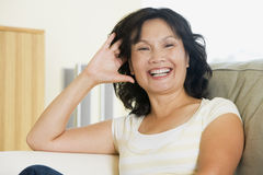 laughing living room sitting woman Στοκ Φωτογραφία