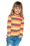 Laughing llittle girl in striped shirt Stock Photo