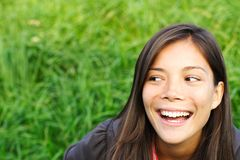 Laughing looking away Royalty Free Stock Images