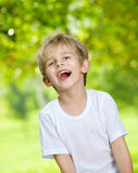 Laughing loudly kid Royalty Free Stock Photos