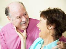 Laughing Loving Senior Couple Stock Photo