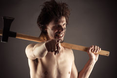 Laughing lumberjack with an ax in hand Royalty Free Stock Photography